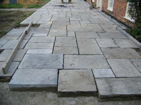 Cathedral grade reclaimed paving laid out on a terrace