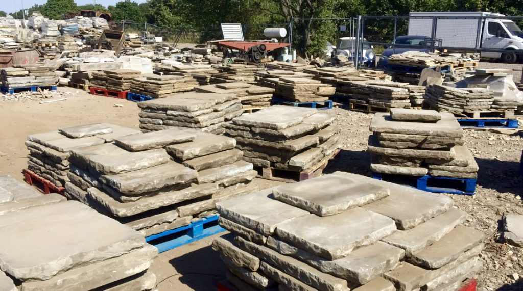reclaimed yorkstone paving stored in stacks at our site