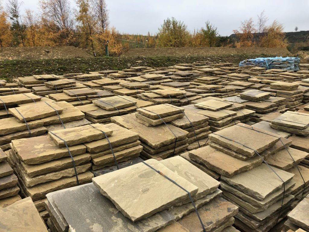 riven yorkstone paving in stacks at our yard